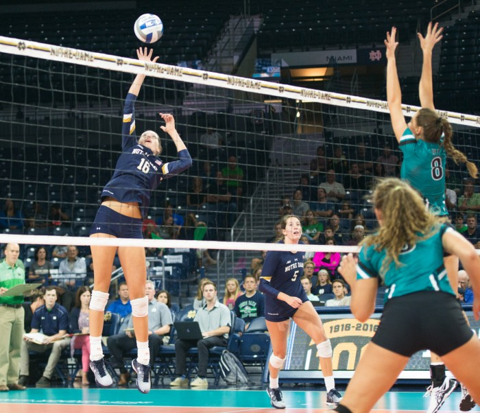 Sophomore Meg Morningstar leaps to make a block during Notre Dame's 3-0 loss to Coastal Carolina on Sept. 2.