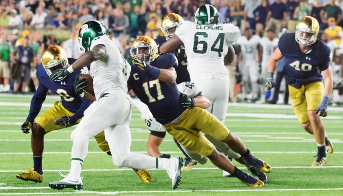 Senior linebacker James Onwaulu tackles the ball carrier during Notre Dame's 36-28 loss to Michigan State on Saturday.