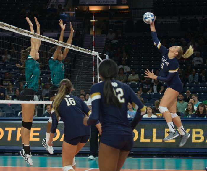 Irish sophomore outside hitter Rebecca Nunge spikes the ball during Notre Dame's 3-0 loss to Coastal Carolina on Sept. 2 at Purcell Pavilion.