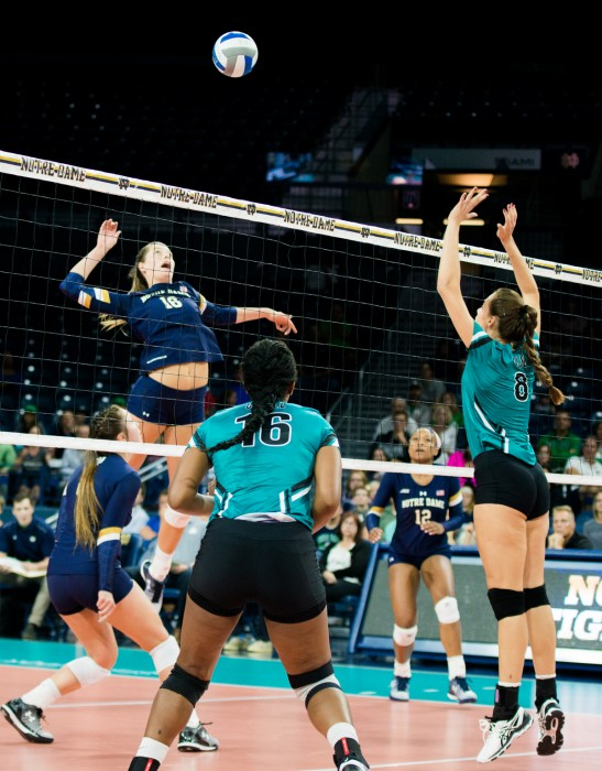 Irish senior middle blocker Katie Higgins winds up to return the ball during Notre Dame's 3-0 loss to Coastal Carolina on Sept. 2.