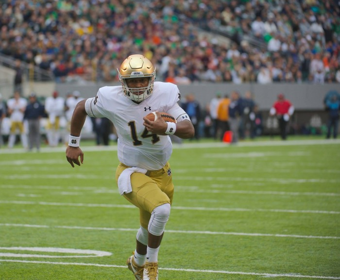 Irish junior quarterback DeShone Kizer runs upfield in Notre Dame's 50-33 victory over Syracuse at MetLife Stadium.