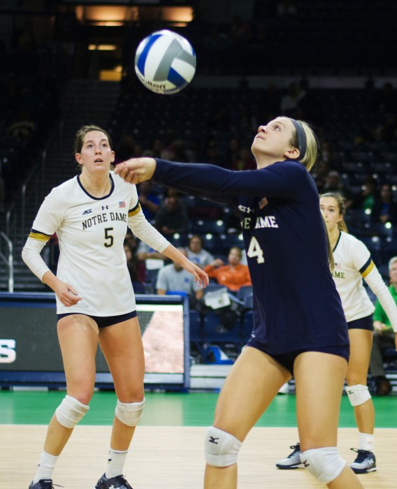 Irish sophomore libero Ryann DeJarld sets the ball during Notre Dame's 3-1 victory over Duke on Friday at Purcell Pavilion.
