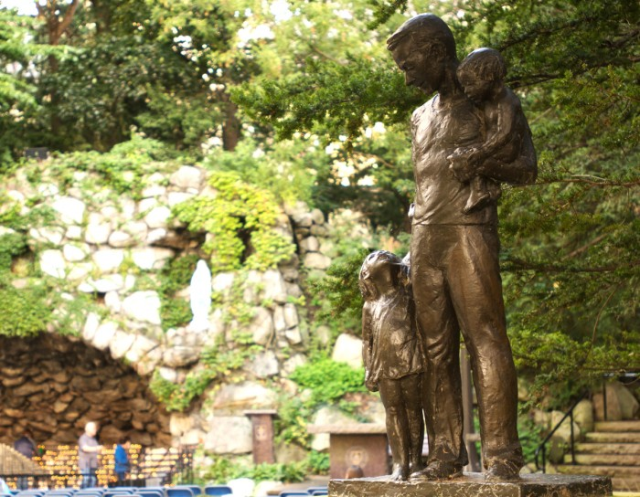The statue of Dr. Tom Dooley stands against the backdrop of the Grotto. Affixed to the statue is a letter from Dooley to University President Emeritus Fr. Theodore Hesburgh, written more than 50 years ago.