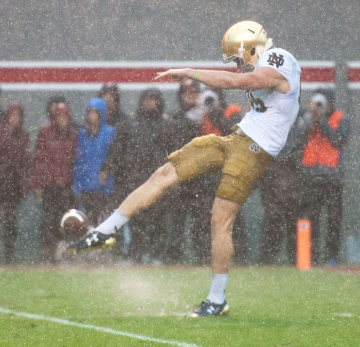 Irish junior punter Tyler Newsome gets off a punt during Saturday's game. N.C. State returned a blocked punt for a touchdown late to win.