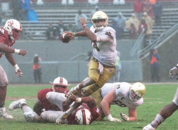 Irish junior quarterback DeShone Kizer throws the ball away under pressure during Notre Dame's loss Saturday at Carter-Finley Stadium.