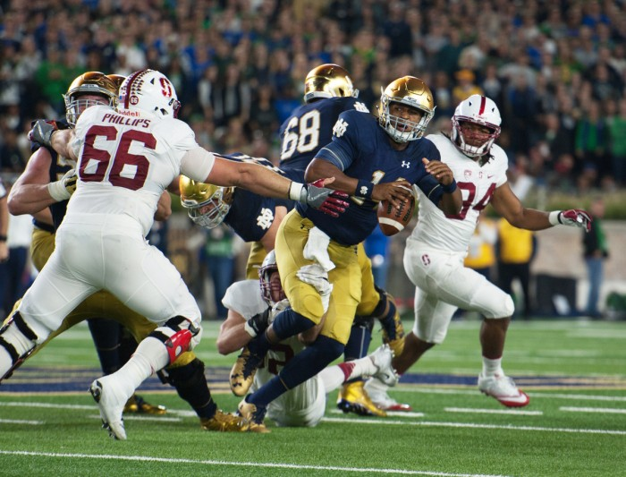 Irish junior quarterback DeShone Kizer scrambles away from a defender in Notre Dame's 17-10 loss to Stanford on Saturday.