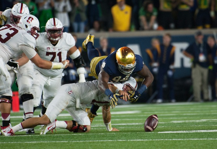 Irish graduate student defensive lineman Jarron Jones dives for a loose ball after sacking senior Stanford quarterback Ryan Burns in Saturday's 17-10 loss to the Cardinal.