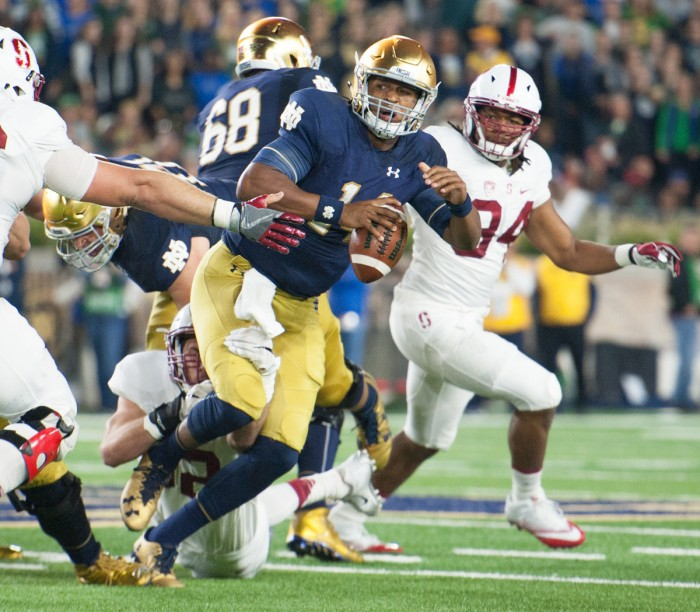 Irish junior quarterback DeShone Kizer scrambles through traffic while keeping his eyes downfield during Notre Dame's 17-10 loss to Stanford on Oct. 15 at Notre Dame Stadium.