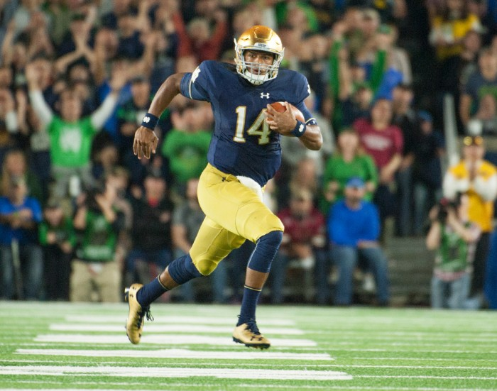 DeShone Kizer tucks the ball and takes off toward the sideline during Notre Dame's loss to Stanford. Kizer finished the game with 154 yards on 14-for-26 passing. He added another 83 yards and a touchdown on 11 rushing attempts, including a 49-yard scamper.