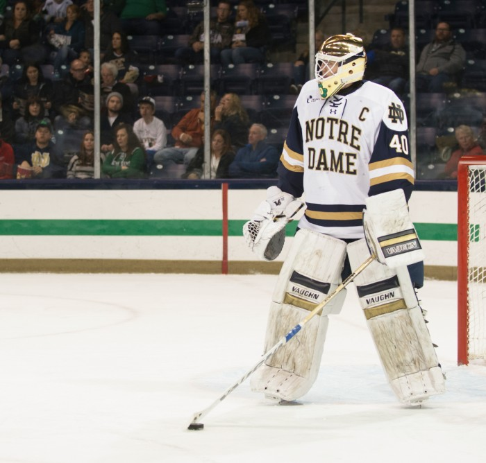Irish junior goaltender Cal Petersen settles the puck during Notre Dame's 3-2 loss in overtime to Penn State on Saturday.