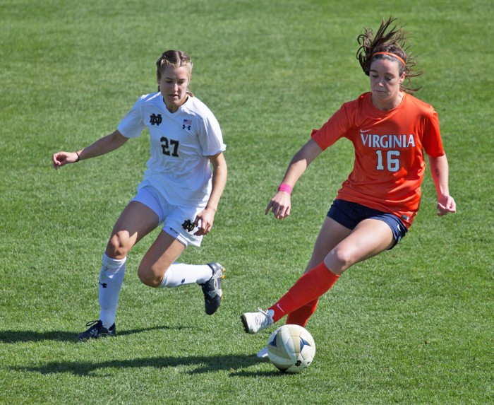 Irish senior forward Kaleigh Olmsted chases down Cavaliers freshman defender Phoebe McClernon during Notre Dame's 1-0 loss against Virginia on Oct. 9 at Alumni Stadium.