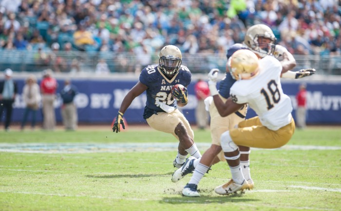 Senior Calvin Cass Jr. of Navy runs for a 37 yard touchdown to give Navy a 21-17 lead with 11:08 left in the 3rd Quarter. ND Freshmen CB Troy Pride Jr. on receiving end of a hard block.