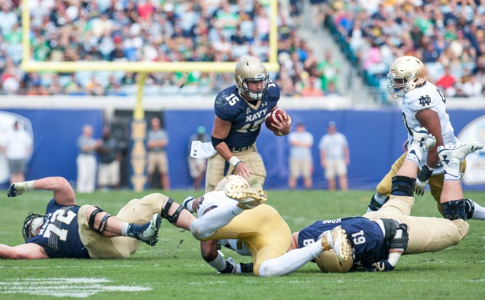Navy QB Will Worth scrambles up the field to set Navy up for a touchdown in the beginning of the 4th Quarter.