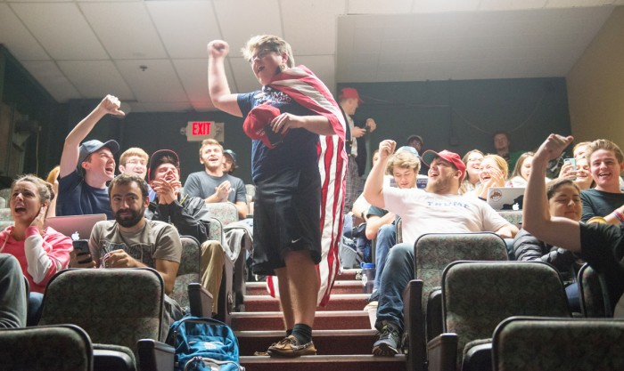 A member of the Notre Dame College Republicans rallies fellow students at the group's watch party in LaFortune Student Center.