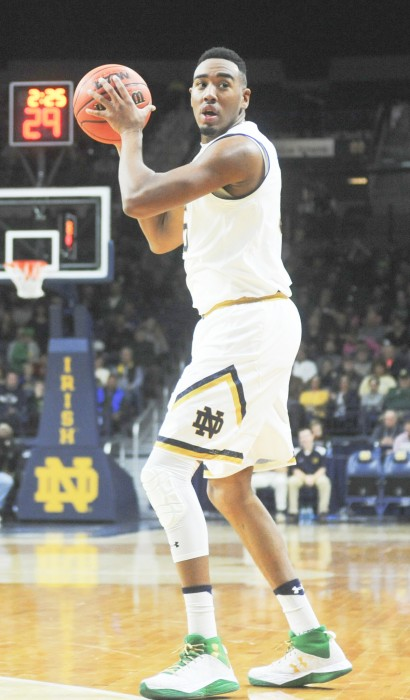 Irish junior forward Bonzie Colson looks to swing the ball around the perimeter during Notre Dame's 89-64 win over Bryant on Saturday at Purcell Pavilion.
