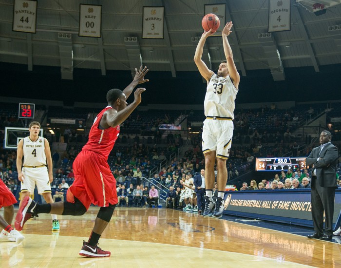 Irish freshman forward John Mooney shoots a three-pointer over the defender during a game against Seattle on Nov. 16.