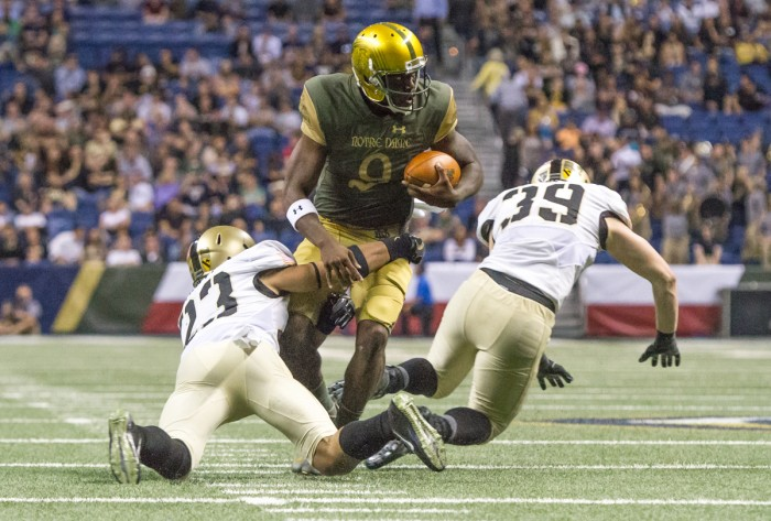 Irish senior quarterback Malik Zaire fights through an arm tackle by an Army defensive back during Notre Dame's 44-6 win at the Alamodome on Nov. 12. Zaire ran for 35 yards in the victory.