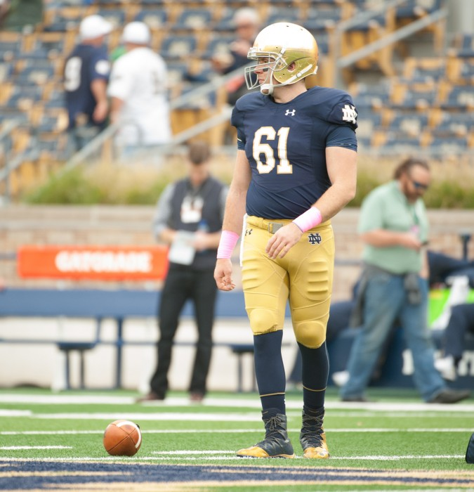 Irish graduate student long snapper Scott Daly warms up before Notre Dame met Miami at Notre Dame Stadium on Oct. 29.