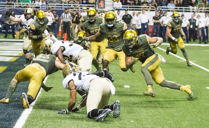 Irish senior linebacker James Onwualu pursues an Army ball carrier near the goal line during Notre Dame's 44-6 victory over the Black Knights at the Alamodome in San Antonio on Nov. 12. Onwualu started his career at Notre Dame as a receiver, but switched to linebacker during his sophomore season and is now one of Notre Dame's four senior captains.