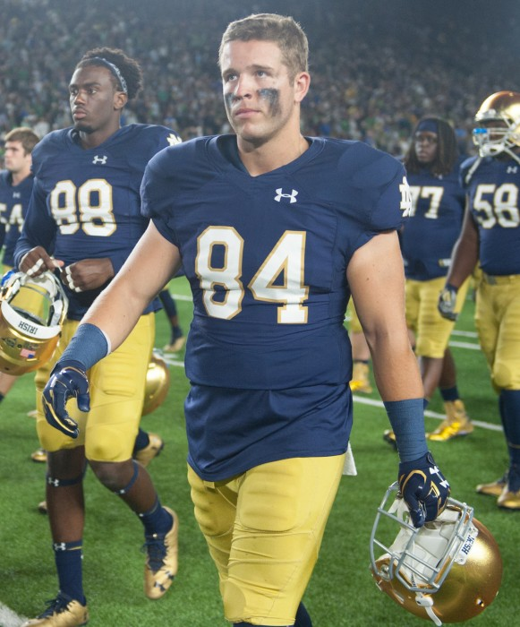 Irish senior Ben Suttman walks over to the student section to sing the Alma Mater after Notre Dame's loss to Michigan State on Sept. 17.