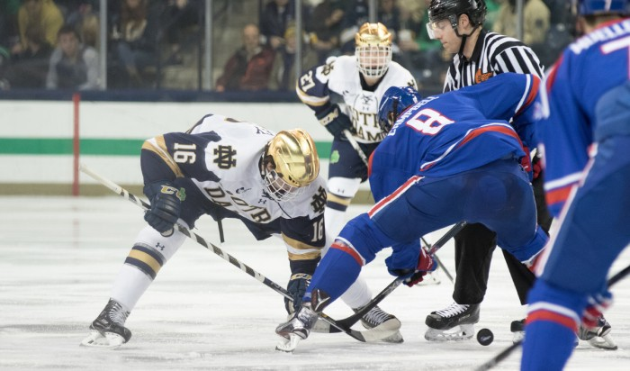 Irish junior forward Connor Hurley takes the face-off during Notre Dame's 4-1 loss to UMass Lowell on Thursday at Compton Family Ice Arena.
