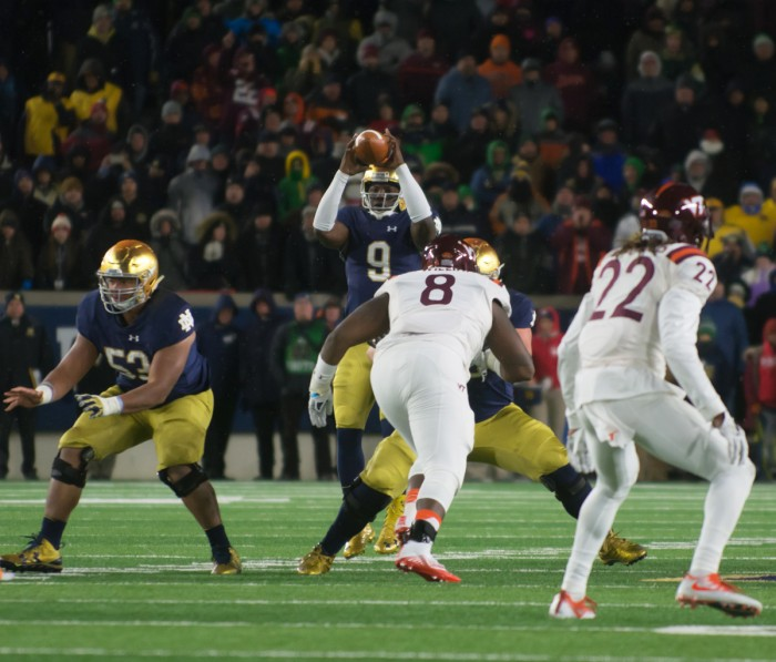 Irish senior quarterback Malik Zaire catches the snap in the final seconds of Notre Dame's 34-31 loss to Virginia Tech.