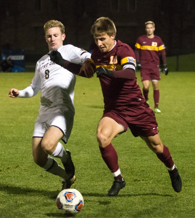 Irish junior forward Jon Gallagher battles for position against a  defender in Notre Dame's 1-0 win over Loyola-Chicago on Sunday.