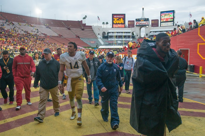 Irish junior quarterback DeShone Kizer walks up the tunnel at the Coliseum after Notre Dame's 45-27 loss to USC on Saturday.