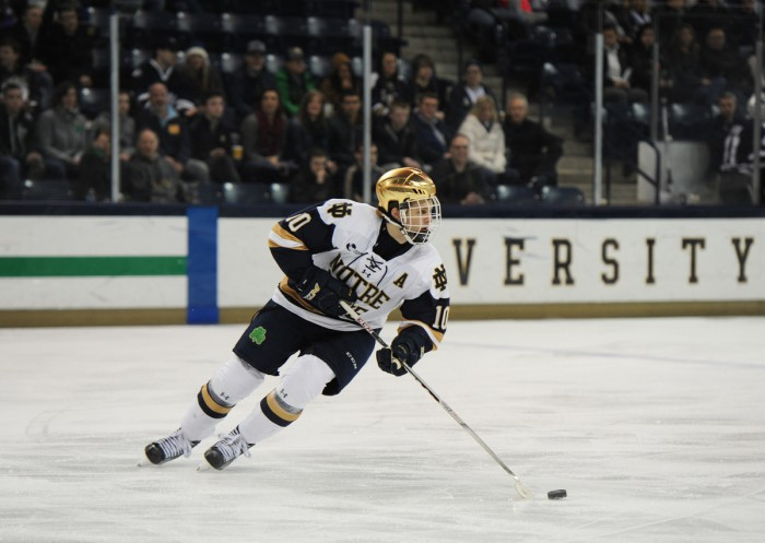 Irish junior forward Anders Bjork surveys the ice during Notre Dame's 2-2 tie against New Hampshire on Friday at Compton Family Ice Arena. Bjork leads the team with 15 goals and 21 assists on the season.