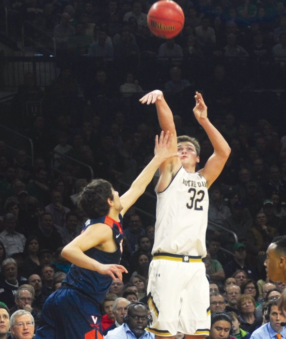 Irish senior guard Steve Vasturia launches a jumper during Notre Dame's 71-54 loss to Virginia on Tuesday at Purcell Pavilion.