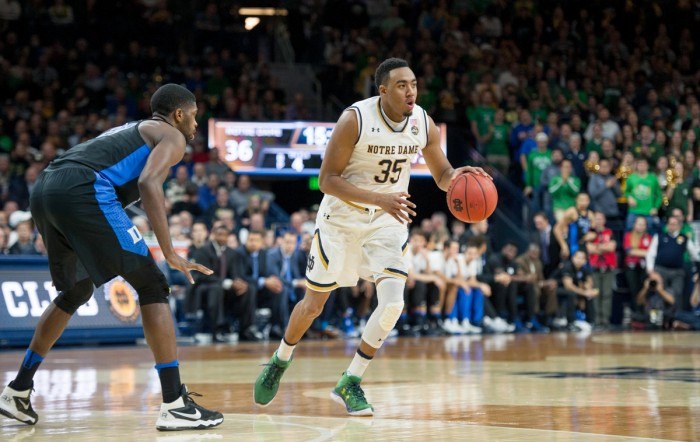 Irish junior forward Bonzie Colson dribbles around the 3-point line during Notre Dame's 84-74 loss to the Blue Devils on Monday at Purcell Pavilion. Colson picked up 17 points and nine rebounds in the game.