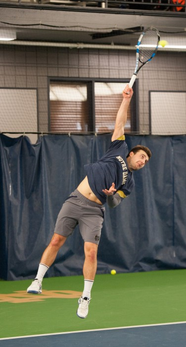 Irish senior Eddy Covalschi serves the ball during Notre Dame's 7-0 win over Boston College on Feb. 11 at Eck Tennis Pavilion.