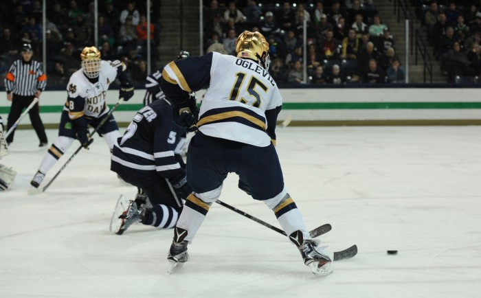 Irish sophomore forward Andrew Oglevie fights for control of the puck during Notre Dame's 2-2 tie with New Hampshire on Jan. 20.
