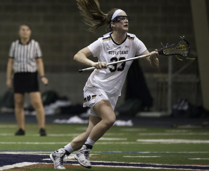 Irish sophomore midfielder Samantha Lynch looks for a pass during Notre Dame's 24-9 win over Detroit on Saturday at Loftus Sports Center.