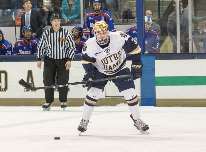 Irish junior defender Jordan Gross looks to pass the puck during Notre Dame's 4-1 loss to UMass Lowell on Nov. 17 at Compton Family Ice Arena. Gross picked up an assist on Notre Dame's lone goal in the game.