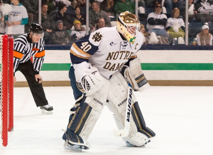 Irish junior goalkeeper Cal Petersen stands in front of the net during Notre Dame's 4-1 victory over Vermont on Feb. 4 at Compton Family Ice Arena.
