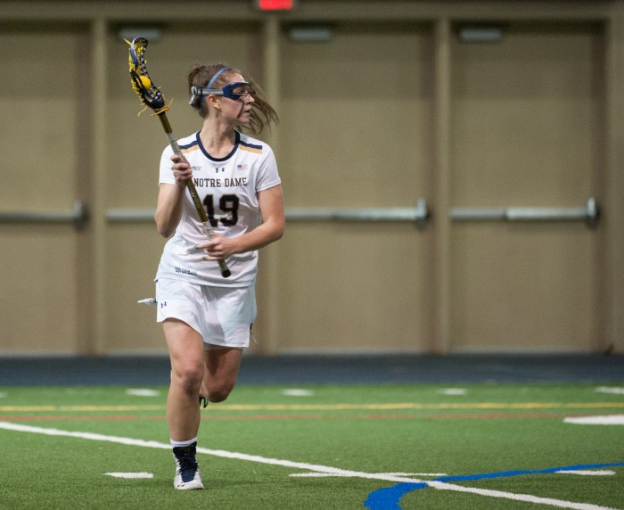 Sophomore midfielder Makenna Pearsall looks to pass during Notre Dame's 24-9 win over Detroit on Feb. 11 at Loftus Sports Center.