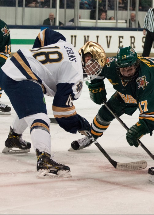 Irish junior forward Jake Evans squares up for a faceoff during Notre Dame's 4-4 tie with Vermont on Feb. 3 at Compton Family Ice Arena.