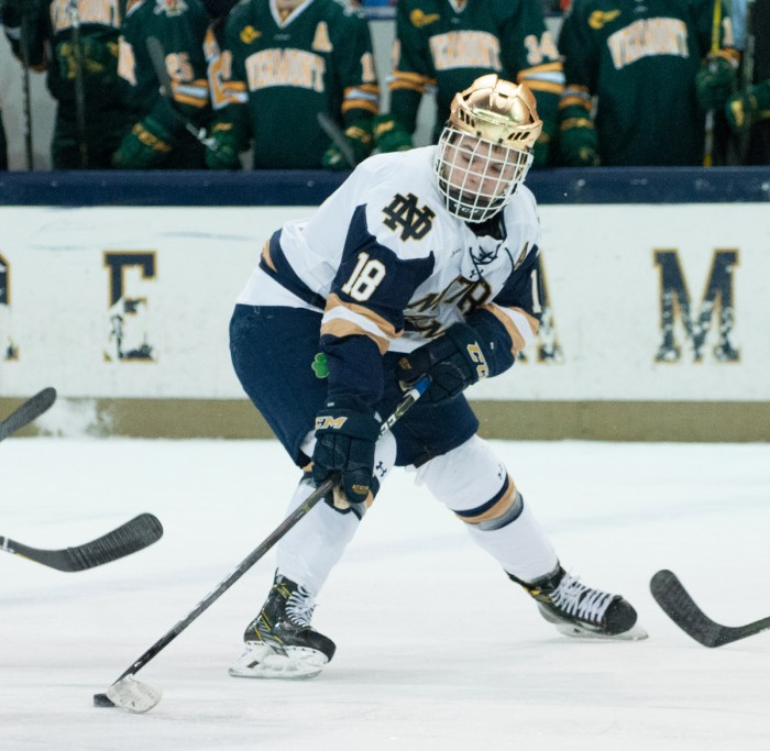 Irish junior forward Jake Evans maneuvers the puck in Notre Dame's 4-4 tie with Vermont on Feb. 3 at Compton Family Ice Arena.