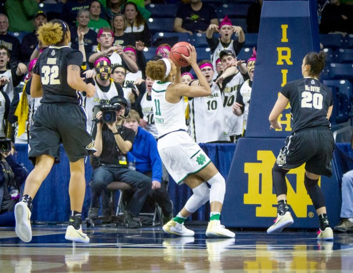 Irish junior forward Brianna Turner catches a pass and looks towards the basket during Notre Dame's 88-82 win over Purdue on Sunday at Purcell Pavilion. Turner injured her left knee on the play, and she is scheduled for an MRI on Monday.