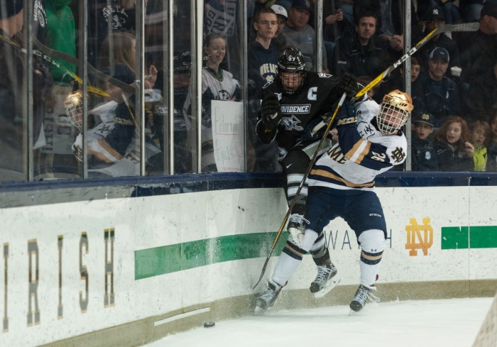 Irish freshman forward Cam Morrison fights for the puck during Notre Dame's 5-2 win over Providence on March 11 at Compton Family Ice Arena.