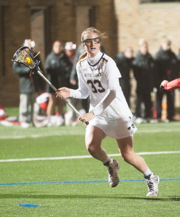 Irish sophomore midfielder Samantha Lynch looks for a teammate during Notre Dame's 16-13 win over Ohio State on March 7 at Arlotta Stadium.