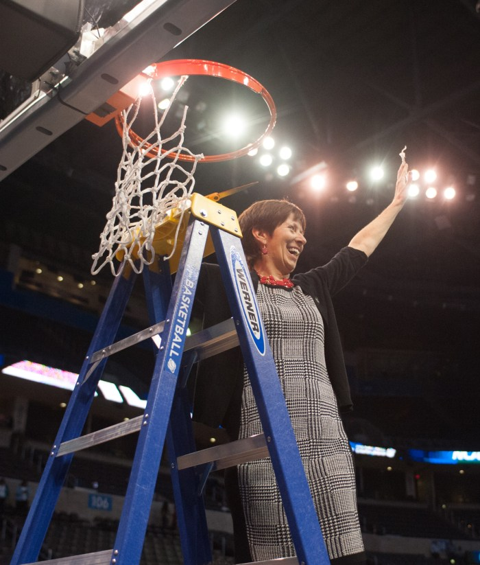 Irish head coach Muffet McGraw cuts down the net after her team defeated Baylor 77-68 in the Elite Eight on March 29, 2015 at Chesapeake Energy Arena in Oklahoma City. McGraw has 853 career wins.