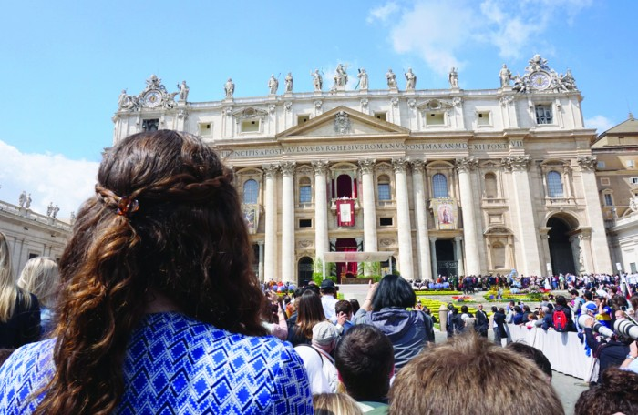 """Junior Elizabeth Crimmins watches Pope Francis deliver his traditional """"Urbi et Orbi"""" Easter message. The pope celebrated Easter Mass in Vatican City and traveled through the crowd in his popemobile."""