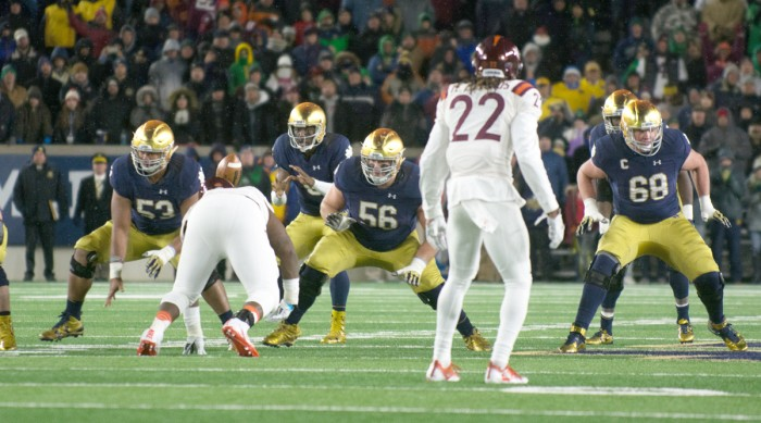Irish senior offensive lineman Quenton Nelson, center, and graduate student offensive lineman Mike McGlinchey, right, drop back in pass protection after a snap during Notre Dame's 34-31 loss to Virginia Tech on Nov. 19 at Notre Dame Stadium. Both Nelson and McGlinchey started all 12 games last season and are captains for the Irish this year.