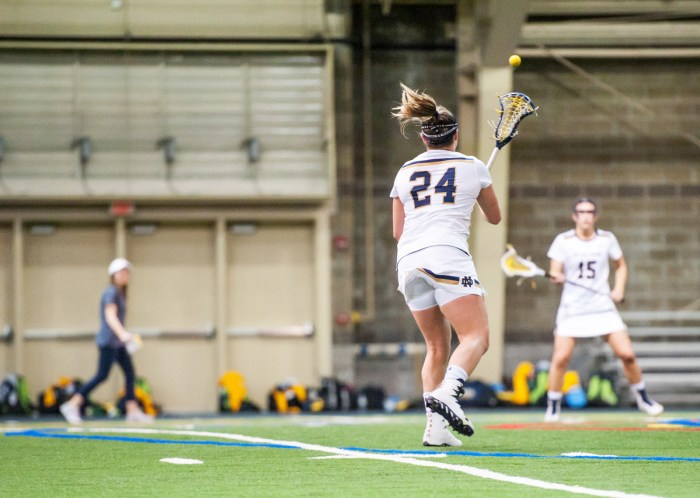 Irish senior midfielder Casey Pearsall fires a pass across the field during Notre Dame's 21-9 win over Marquette at Loftus Sports Center on Feb. 14.