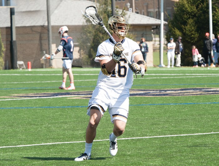 Irish senior midfielder Sergio Perkovic looks for the ball during Notre Dame's 11-10 loss to Syracuse on April 1 at Arlotta Stadium.
