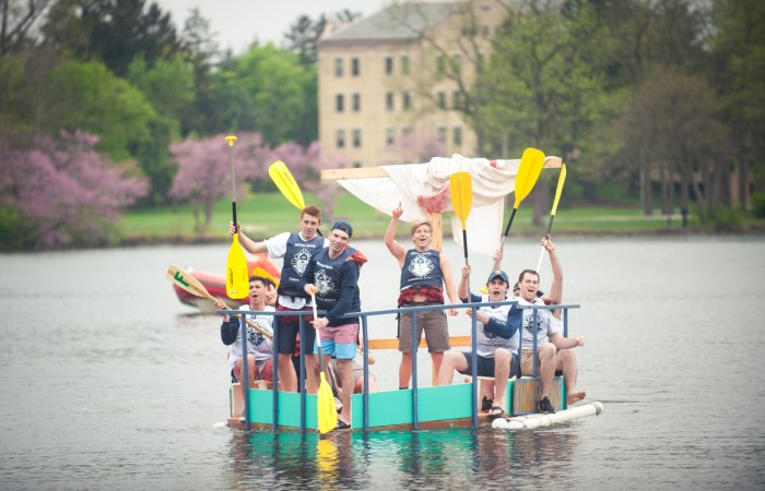 "Participants travel across St. Mary's Lake during Saturday's event. A team of freshmen from Fisher Hall won this year's Fisher Regatta with their boat ""Floaty McFloatface."""