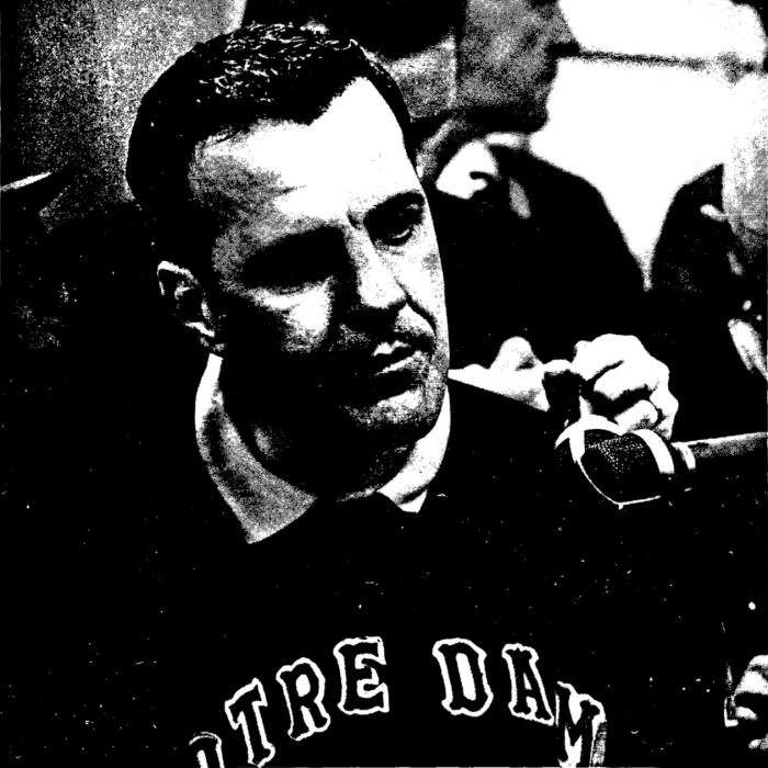 Former Irish head coach Ara Parseghian collects his thoughts before addressing the press following Notre Dame's 51-0 win over USC on Nov. 26, 1966. The Irish won their first of two championships under Parseghian that year.