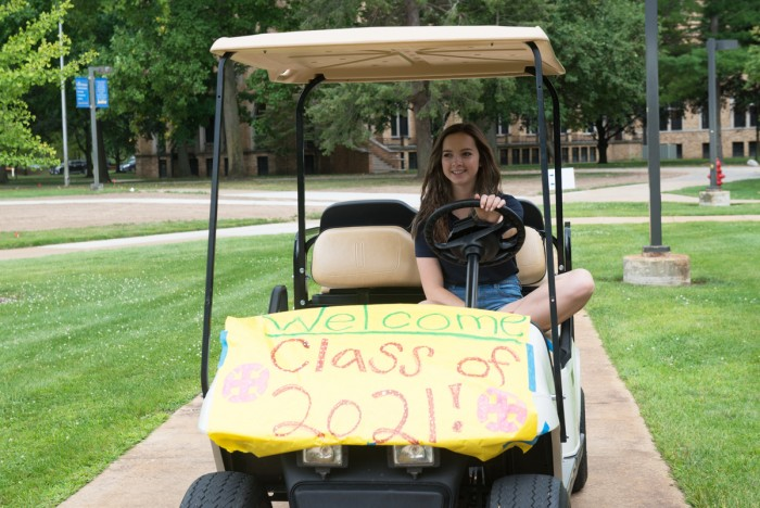 Senior Stephanie Stapleton welcomes incoming Belles to campus by displaying posters with uplifting  messages and by transporting members of the class of 2021 to various campus destinations in golf carts.